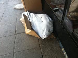 A man sleeping in a sack!